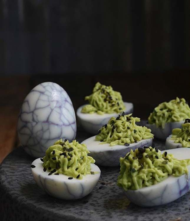 Spider Eggs: Avocado & Wasabi Deviled Eggs | FamilySpice.com. Serve this sophisticated appetizer for Halloween parties.