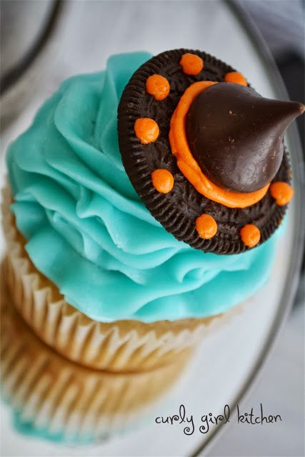 Halloween Cupcakes - make witches' hats from half an Oreo, orange icing, and a Hershey's Kiss